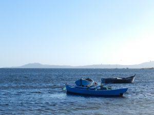 Porto Botte, Boot und Kitesurfer