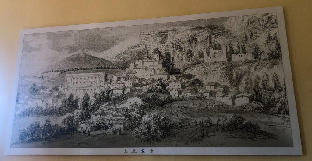 Das Wandgemälde zeigt den neu gebauten Palazzo Aymerich und die Burgruine in Laconi